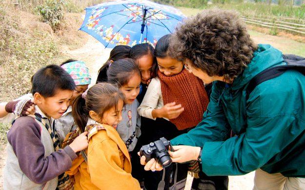 Group of Laos children look at traveler's camera