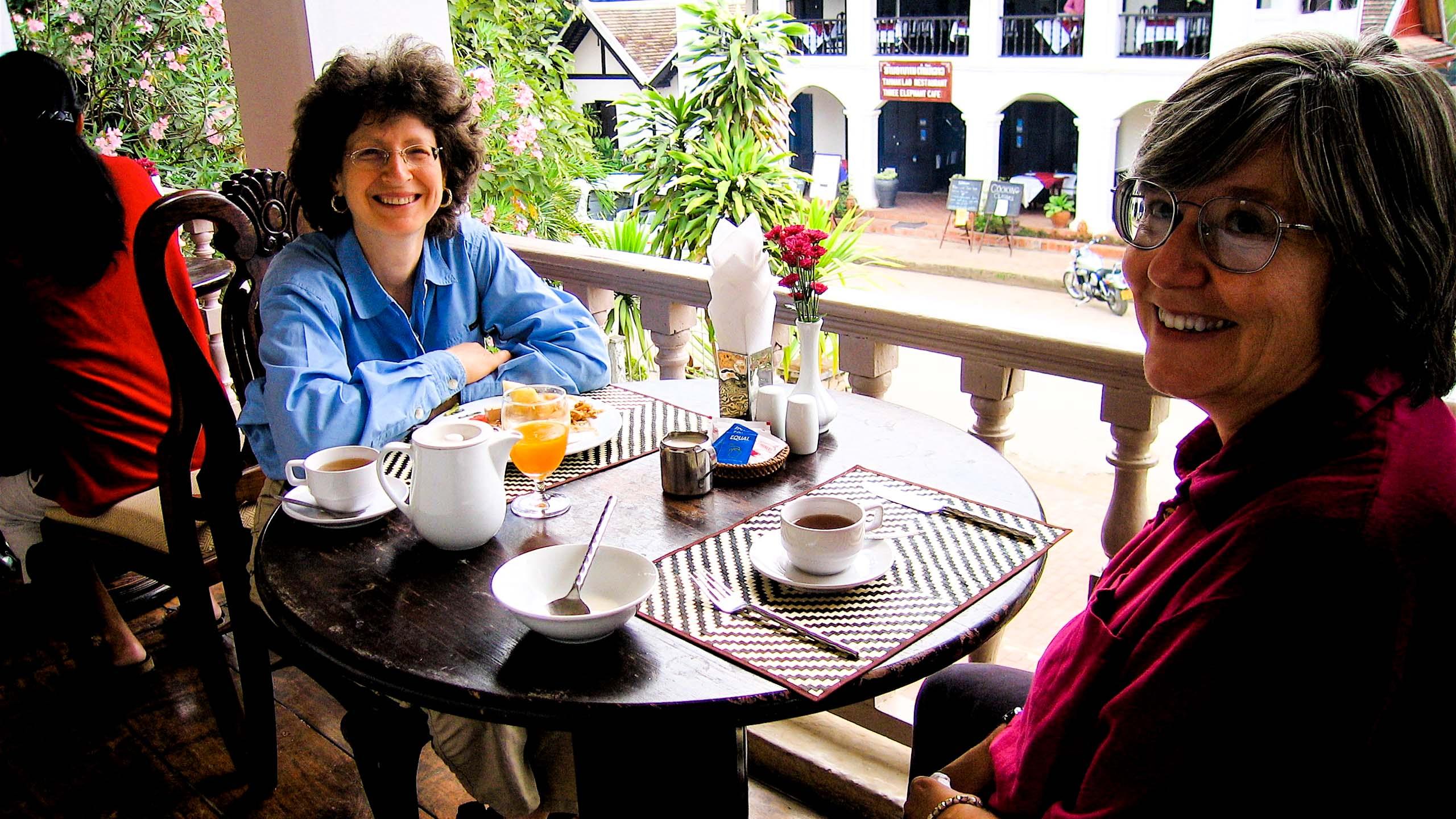 Two women enjoy a Laos cafe