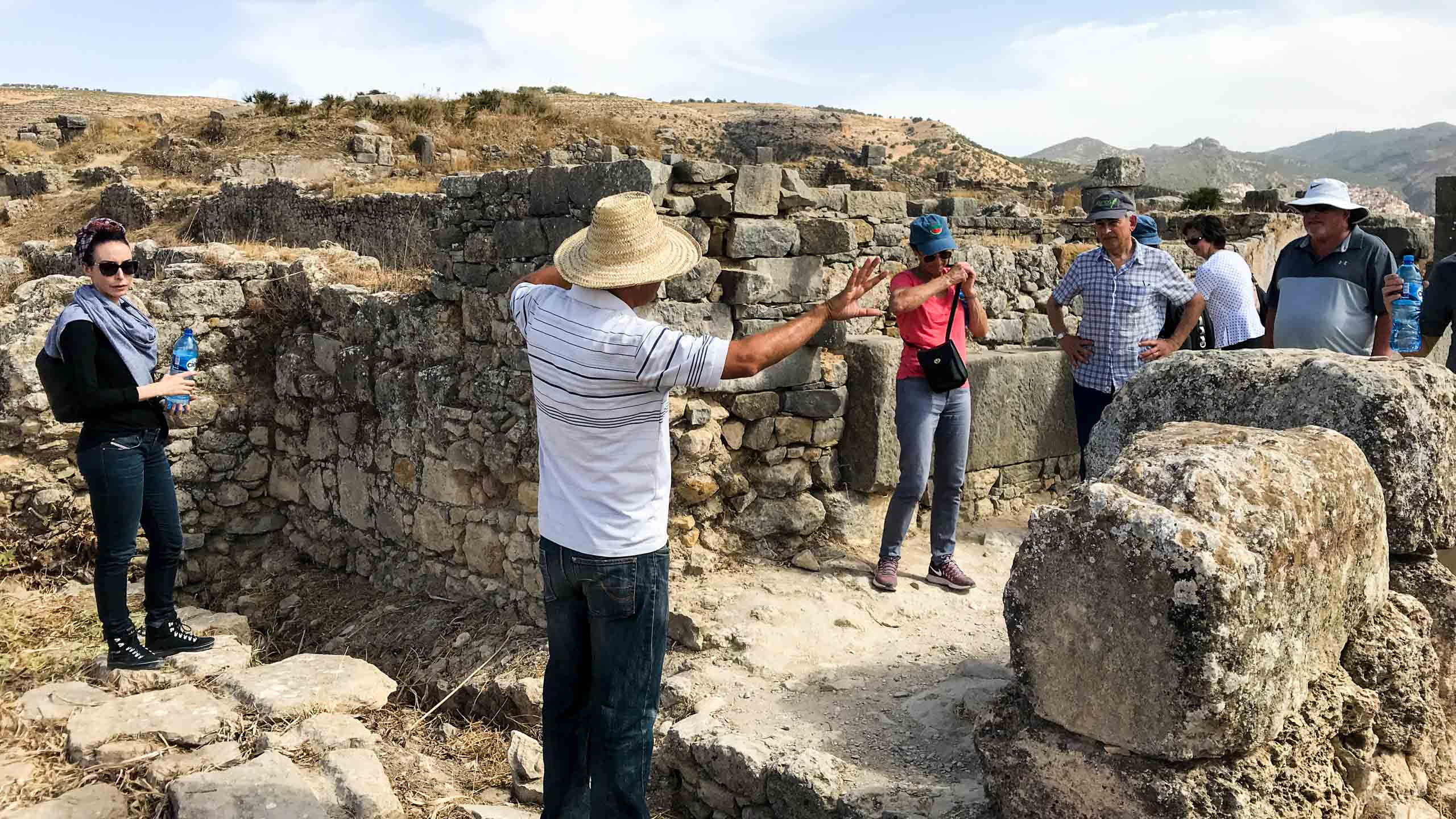 Tour group explores Morocco ruins