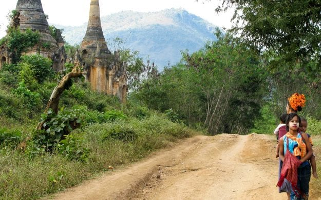 People standing on Myanmar country road