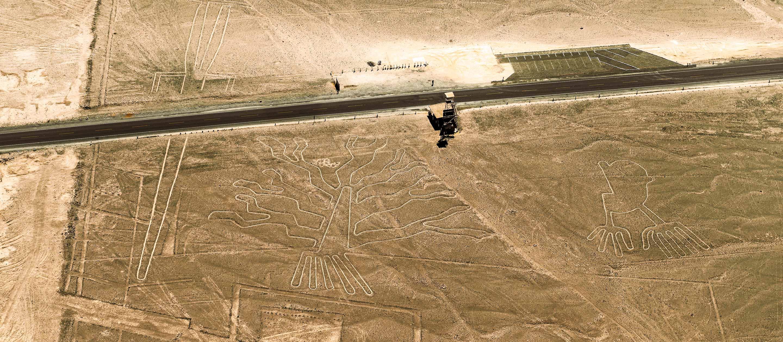 Desert road runs past Nazca Lines in Peru