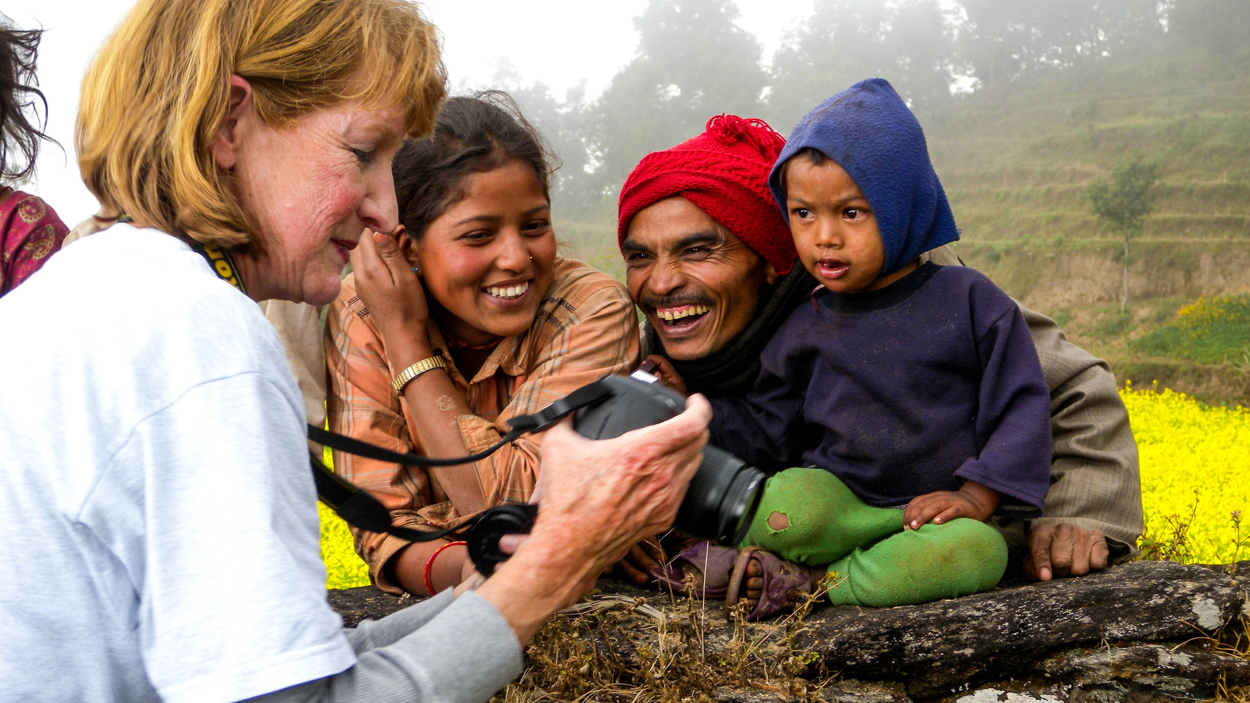Woman shares digital photos with Nepal family
