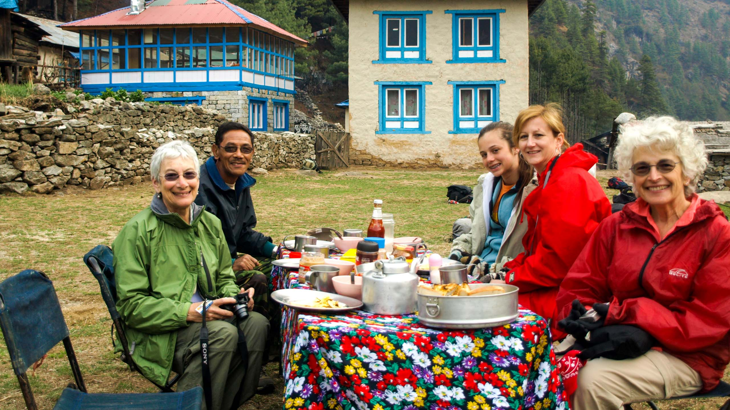 Family eats meal on trip to Nepal