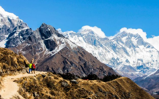 Hikers on trail in Nepal mountains