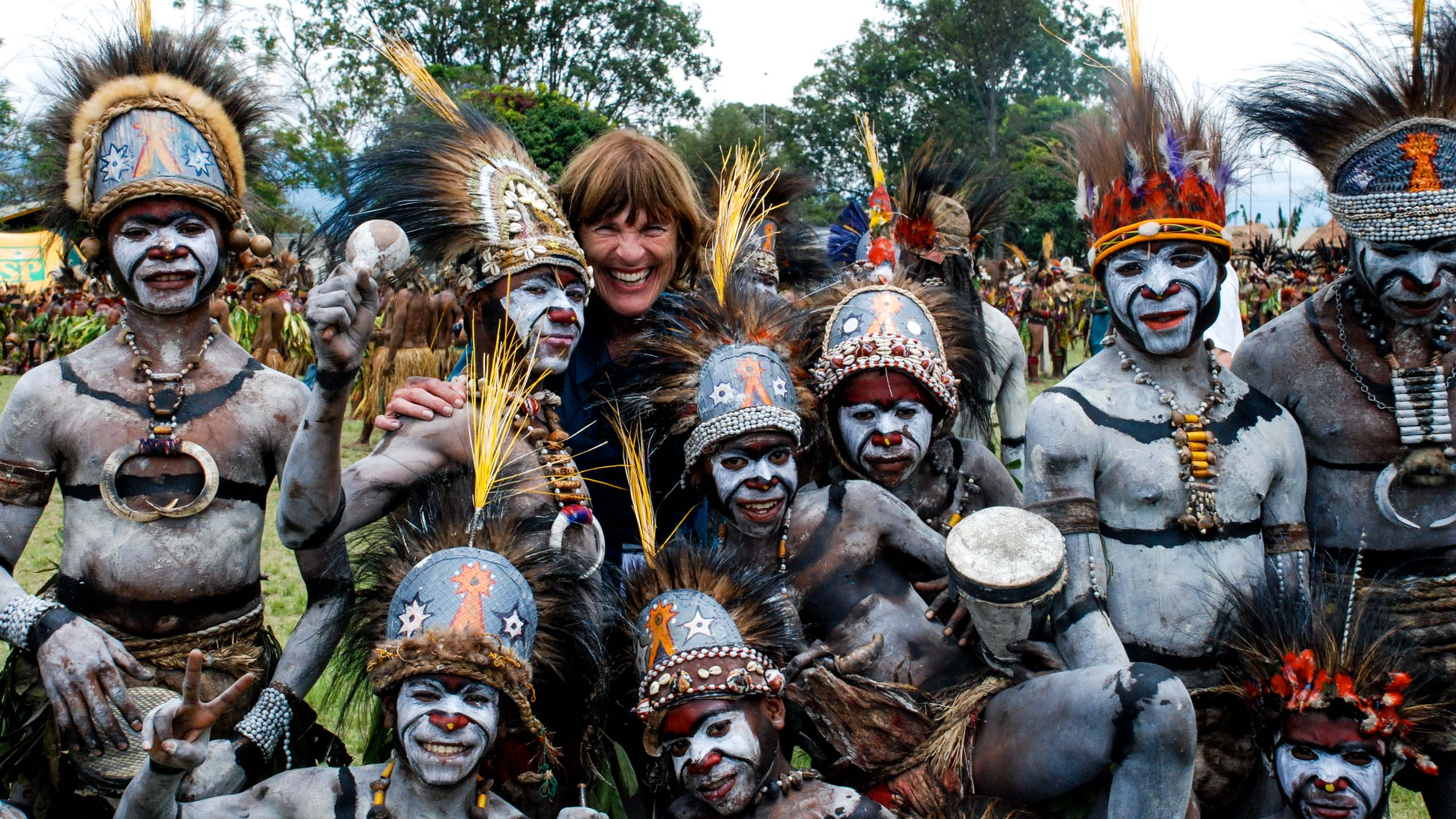 Traveler stands with Papua New Guinea tribe