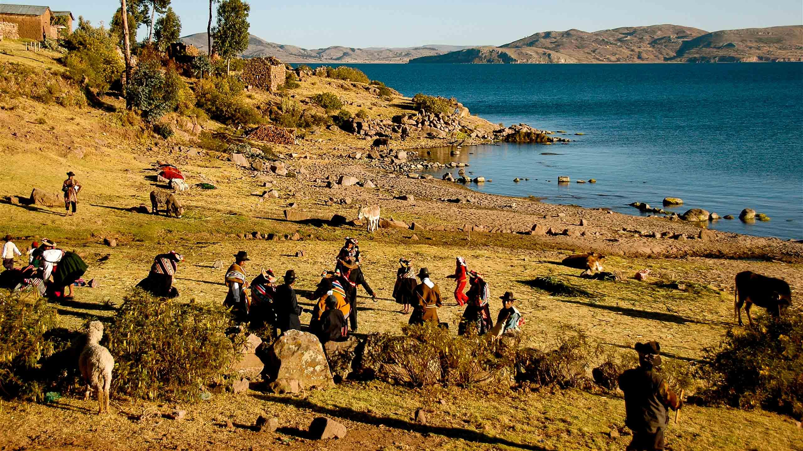 Peru people on plain near water