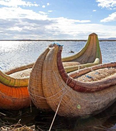 Straw canoes waiting on Peru shore