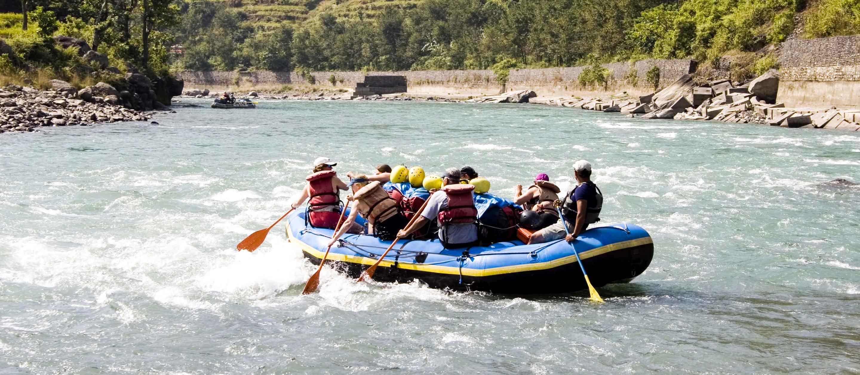 Group of travelers raft in Nepal