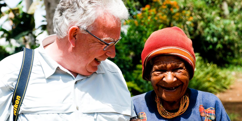 Traveler and Papua New Guinea native smiling