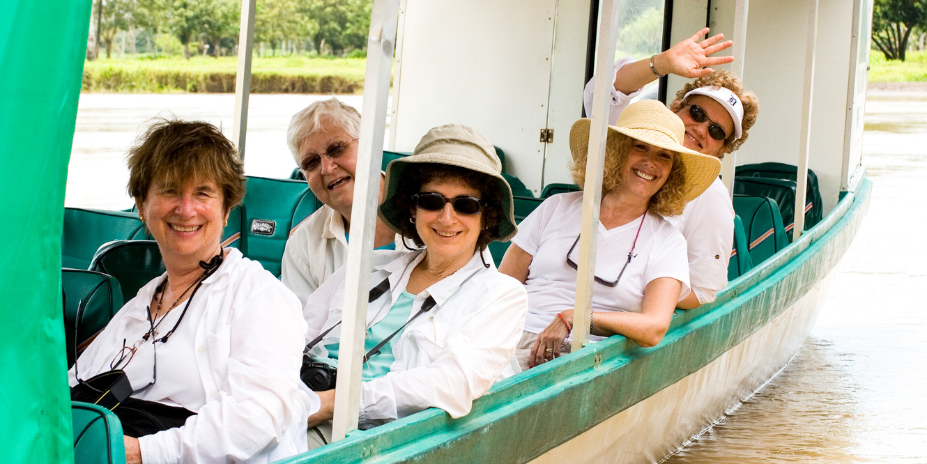 Group of travelers on boat tour