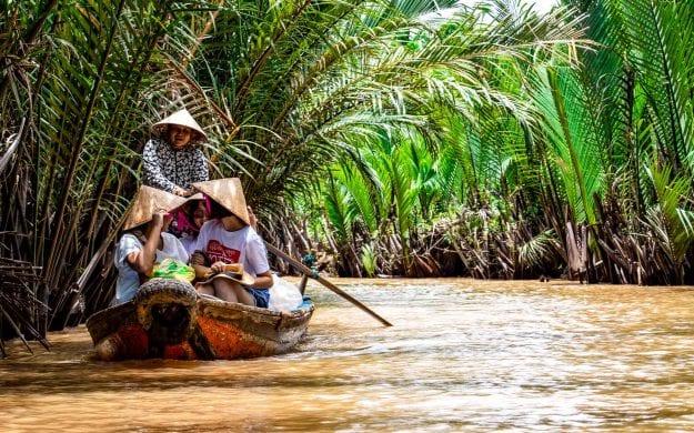 People in boat on Mekong River in Vietnam
