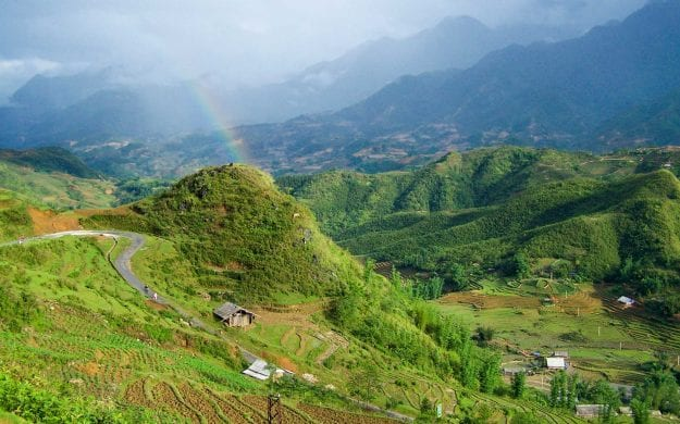 Rainbow over green Vietnam valley