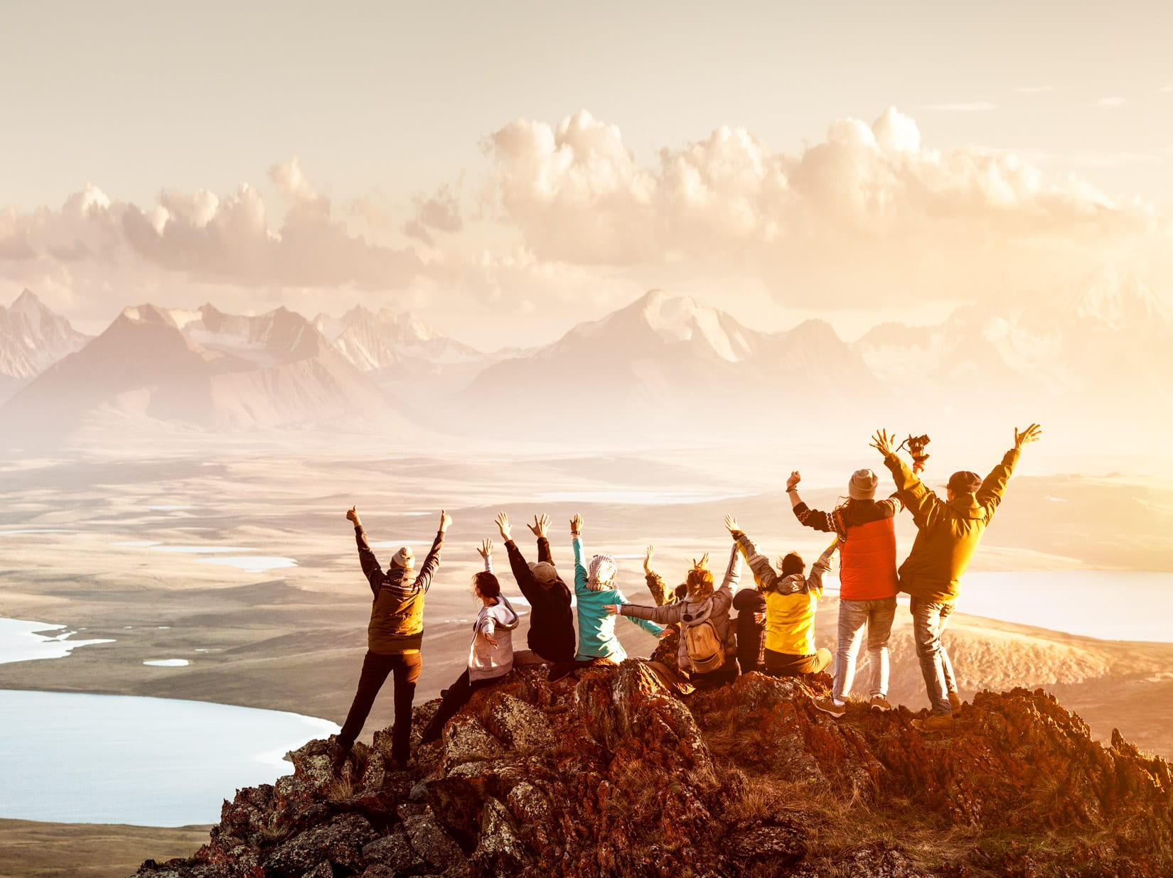 Travel group cheers from mountain top