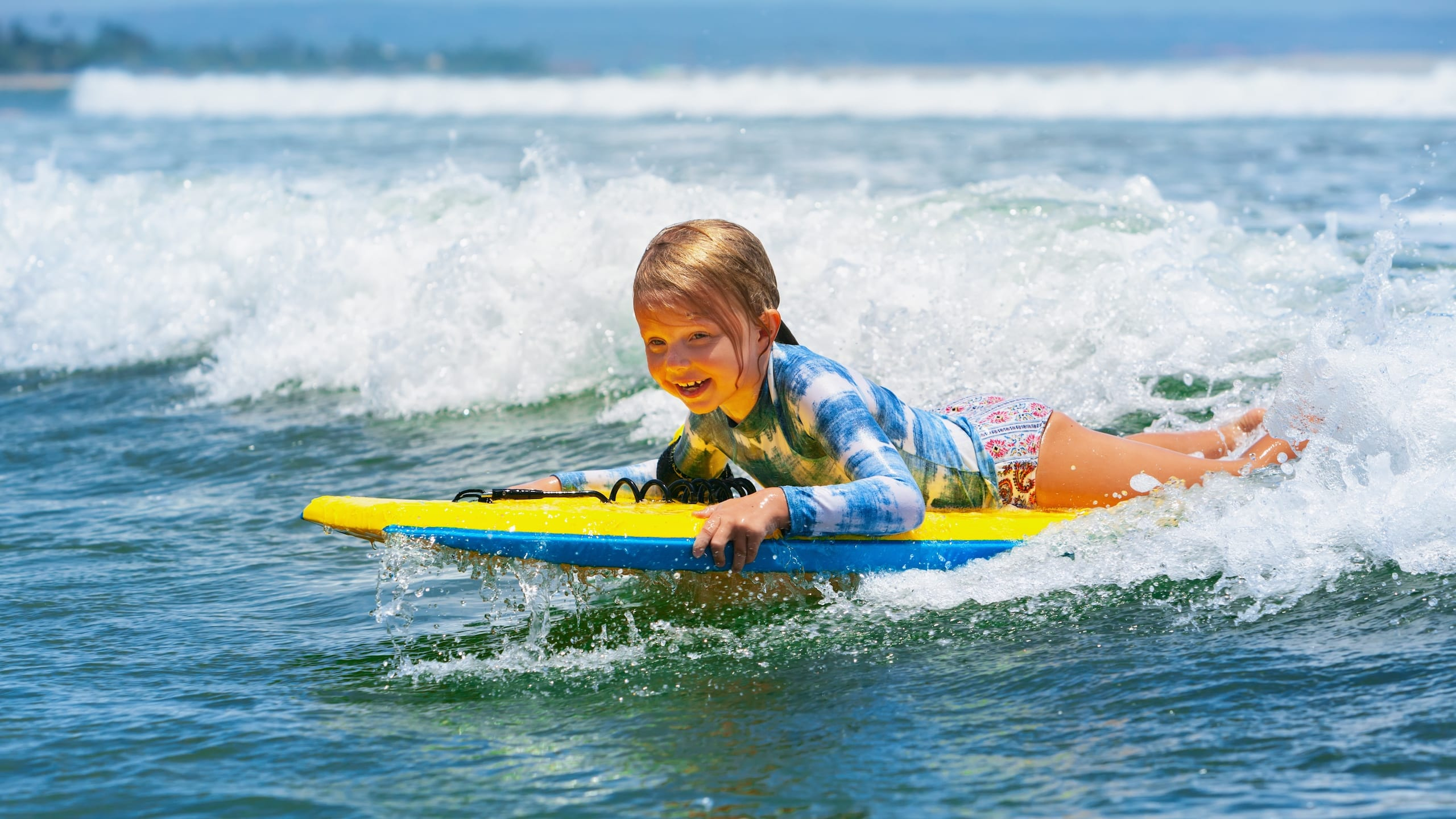 girl lying on surf board