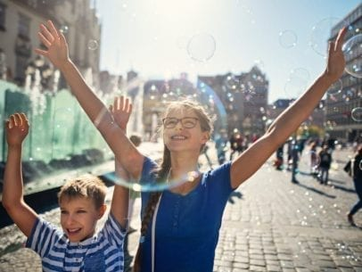 kids with bubbles in Polish town square
