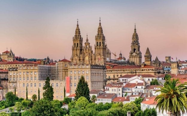 Hazy sunset on Santiago de Compostela cathedral and city view.
