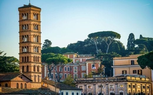 The sunset light illuminates the Aventine Hill in Rome