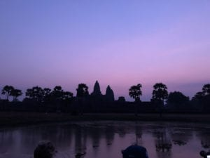 Angkor Wat silhouette against purple sky