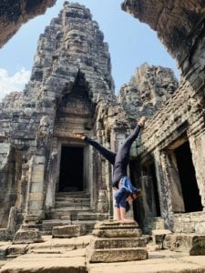 woman doing handstand in temple