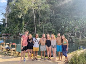 group of people by jungle pool