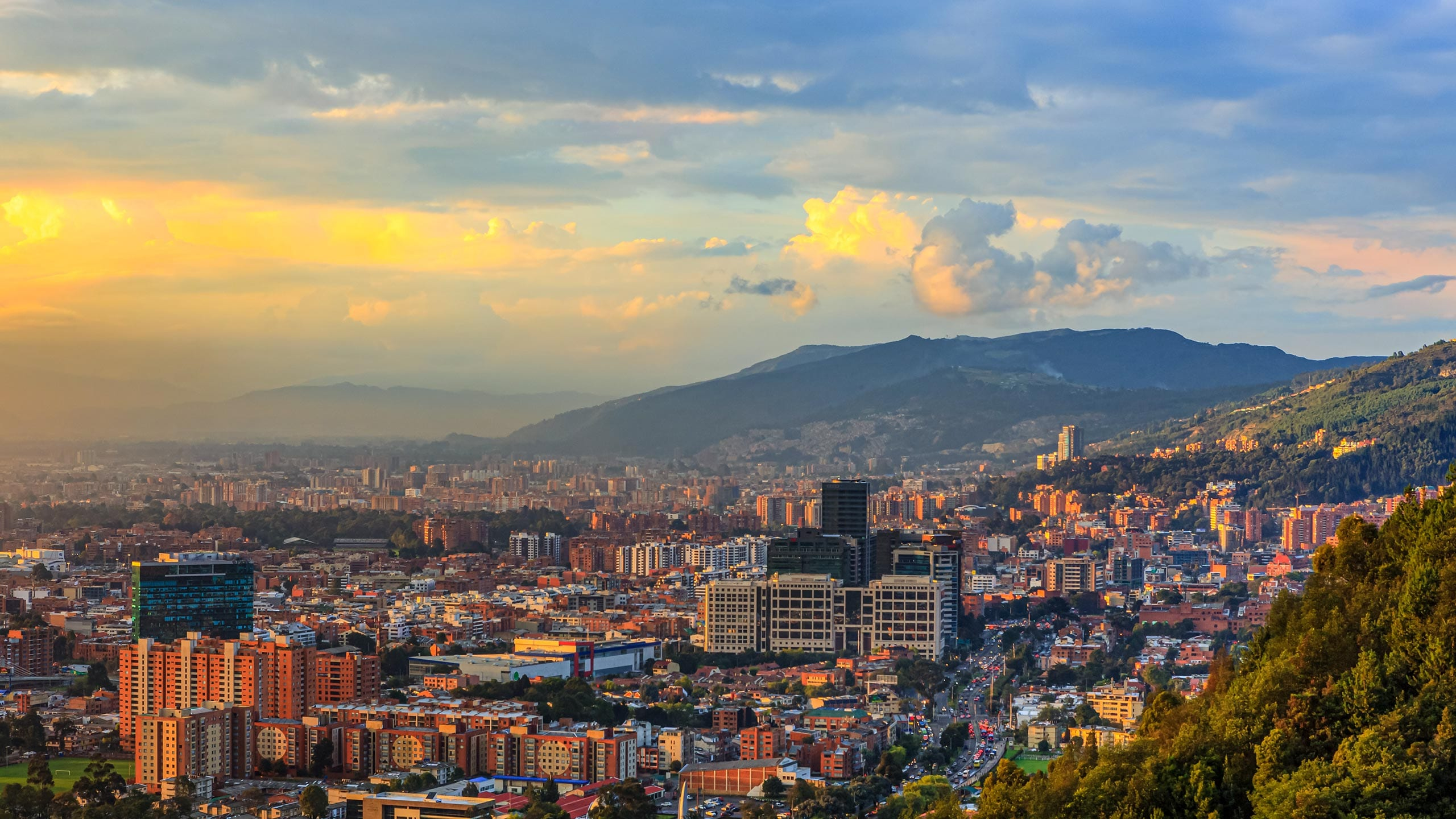 Bogota, Colombia - High Angle Panoramic View Of The Andean Capital City From The Heights Of La Calera On The Andes At Sunset Time