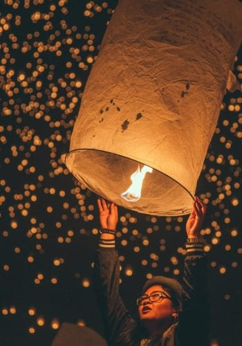 releasing lantern into the sky