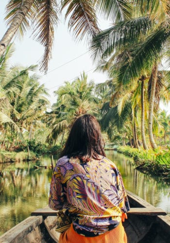 woman boating on tropical river