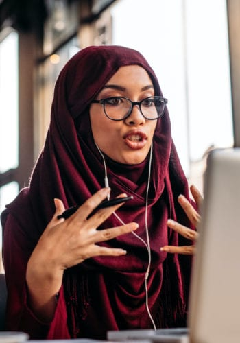 woman in hijab at computer