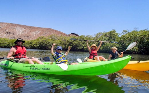 Family kayaking in Balandra Bay, Mexico