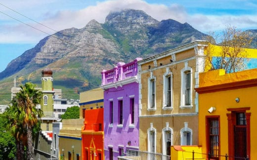 Cape town Bo Kaap Malay quarter rooftops with table mountain in the background, featuring the typical colorful houses.