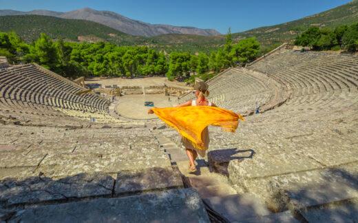 Woman walking down stairs in Epidaurus amphitheater