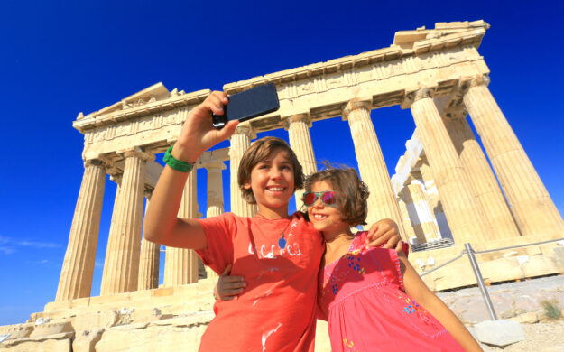 Kids taking selfie in front of Parthenon