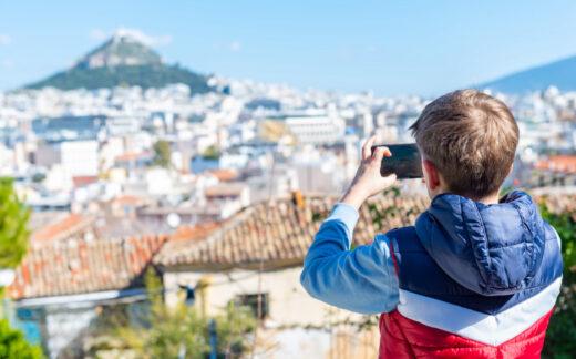 Boy taking photo of Lycabettus Hill